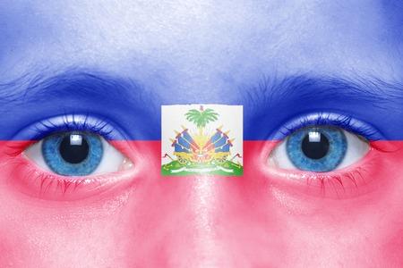haitian: humans face with haitian flag