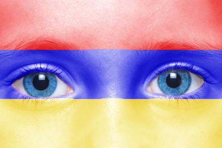 armenian woman: humans face with armenian flag Stock Photo