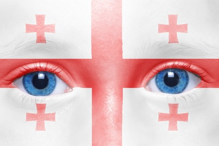 georgian: humans face with georgian flag Stock Photo