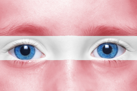 latvia girls: humans face with latvian flag Stock Photo