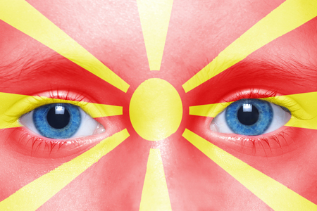 macedonian flag: humans face with macedonian flag