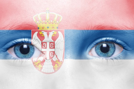 serbian: humans face with serbian flag