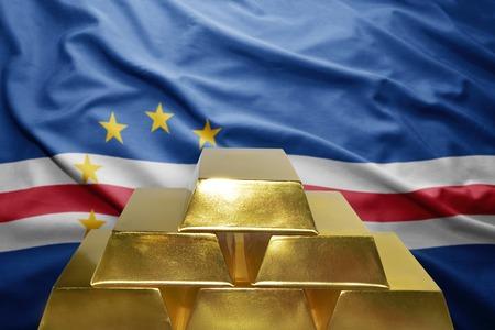 cape verde flag: shining golden bullions on the cape verde flag background Stock Photo
