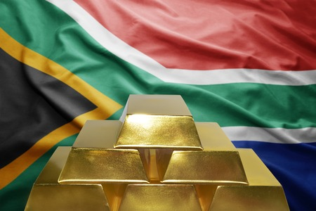 south africa flag: shining golden bullions on the south africa flag background