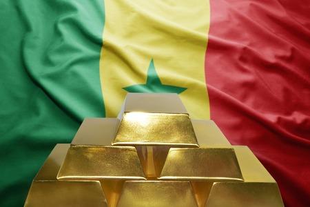 senegalese: shining golden bullions on the senegalese flag background