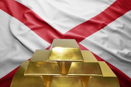 alabama flag: shining golden bullions on the alabama flag background