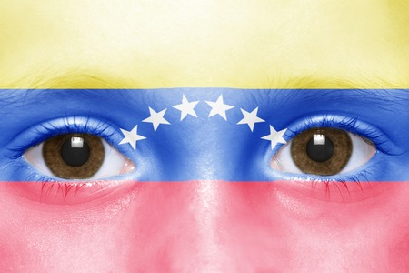 venezuelan: humans face with venezuelan flag Stock Photo