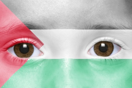 palestinian: humans face with palestinian flag Stock Photo