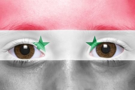 syrian: humans face with syrian flag Stock Photo