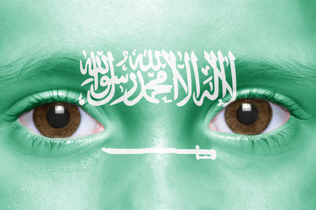 saudi arabia: humans face with saudi arabia flag Stock Photo