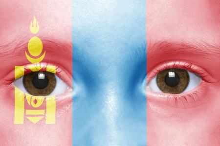 mongolian: humans face with mongolian flag Stock Photo