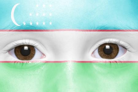 uzbek: humans face with uzbek flag