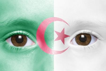 algerian flag: humans face with algerian flag Stock Photo