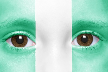 nigerian: humans face with nigerian flag