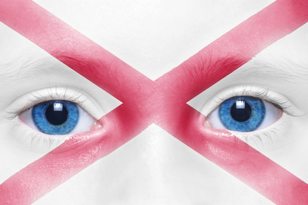 visions of america: humans face with alabama state flag