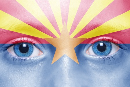 visions of america: humans face with arizona state flag