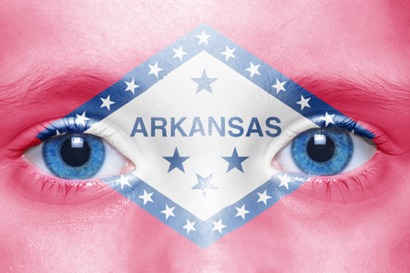 visions of america: humans face with arkansas state flag Stock Photo