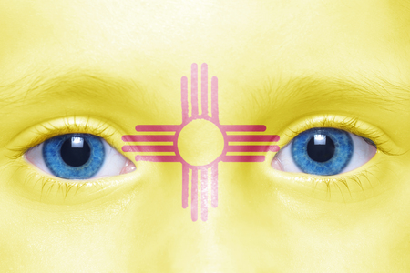 visions of america: humans face with new mexico state flag Stock Photo