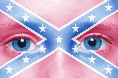 human's face with confederate navy jack flag