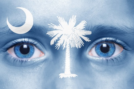 visions of america: humans face with south carolina state flag