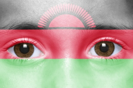 malawi flag: humans face with malawi flag