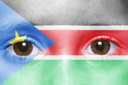 south sudan: humans face with south sudan flag Stock Photo