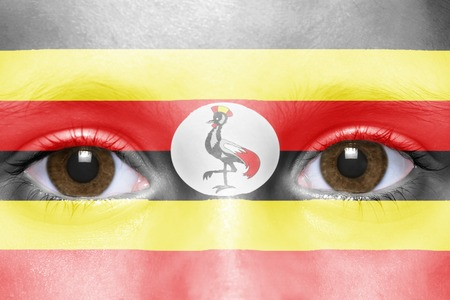 ugandan: humans face with ugandan flag Stock Photo