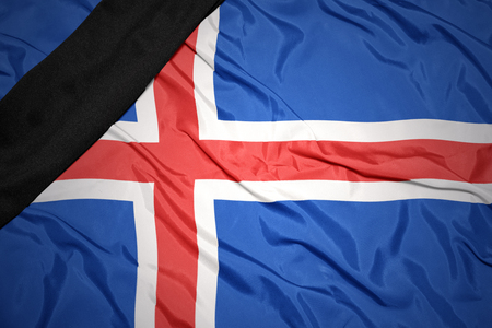 dole: waving national flag of iceland with black mourning ribbon