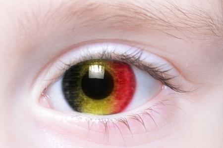 belgium: humans eye with national flag of belgium
