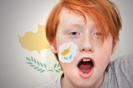 cypriot: redhead fan boy with cypriot flag painted on his face. on the cypriot flag background