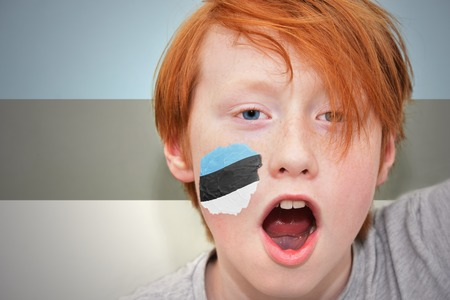 estonian: redhead fan boy with estonian flag painted on his face. on the estonian flag background