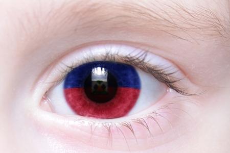 port au prince: humans eye with national flag of haiti