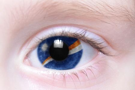 marshall: humans eye with national flag of marshall islands