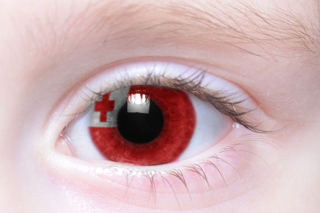 tonga: humans eye with national flag of tonga