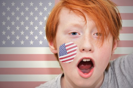 redhead fan boy with american flag painted on his face. on the american  flag background