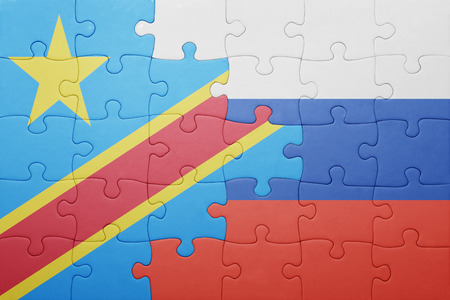 puzzle with the national flag of russia and democratic republic of the congo . concept
