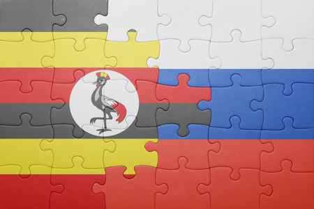 kampala: puzzle with the national flag of russia and uganda . concept Stock Photo