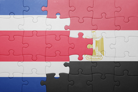 costa rican flag: puzzle with the national flag of costa rica and egypt. concept