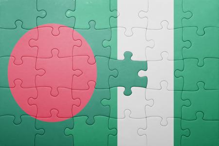 national flag bangladesh: puzzle with the national flag of bangladesh and nigeria . concept