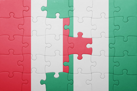 lima region: puzzle with the national flag of peru and nigeria . concept