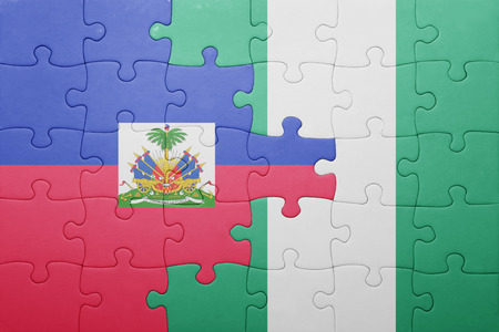 port au prince: puzzle with the national flag of haiti and nigeria . concept