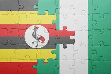 kampala: puzzle with the national flag of uganda and nigeria . concept Stock Photo