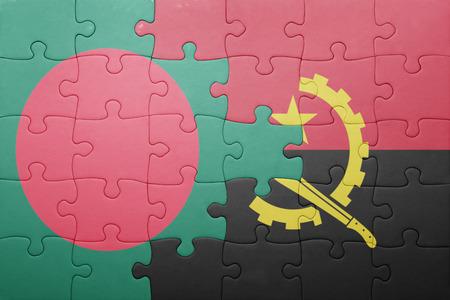 national flag bangladesh: puzzle with the national flag of angola and bangladesh . concept Stock Photo