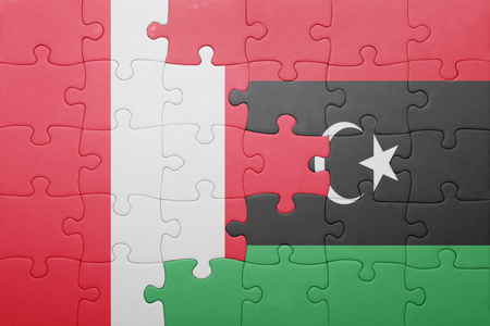 lima region: puzzle with the national flag of peru and libya . concept