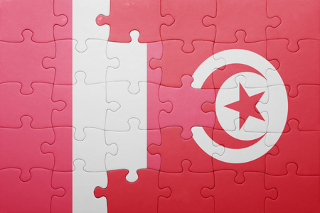 lima region: puzzle with the national flag of tunisia and peru . concept Stock Photo