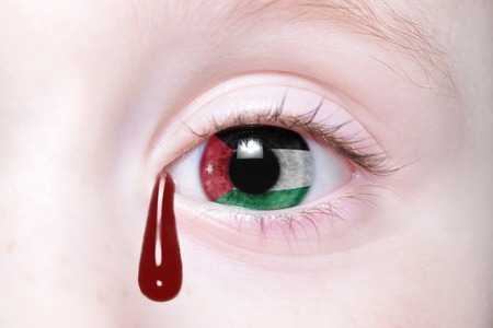 humans eye with national flag of jordan with bloody tears. concept
