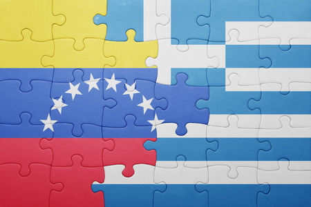 territories: puzzle with the national flag of venezuela and greece . concept