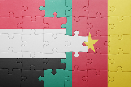 middle east conflict: puzzle with the national flag of yemen and cameroon . concept