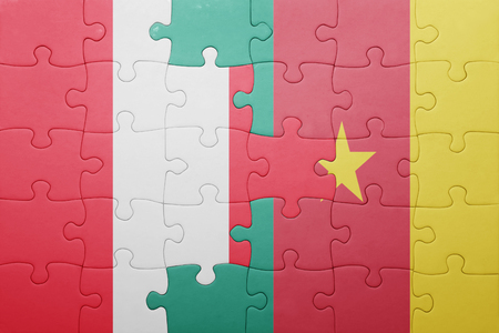 lima region: puzzle with the national flag of peru and cameroon . concept Stock Photo