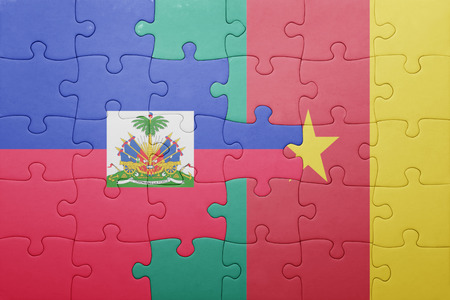 port au prince: puzzle with the national flag of haiti and cameroon . concept Stock Photo